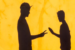 Teenagers Shadows Wall Paper Scissors Royalty Free Stock Photo