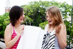 Teenagers with a shopping bag Stock Photo