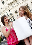 Teenagers with a shopping bag Stock Photos