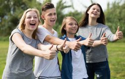 Teenagers show their thumbs up Royalty Free Stock Photos