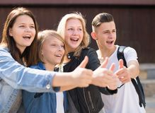 Teenagers show their thumbs up Stock Image