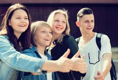 Teenagers show their thumbs up royalty free stock image