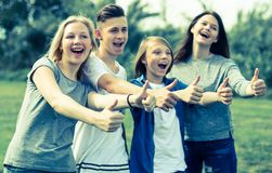 Teenagers show their thumbs up stock photography