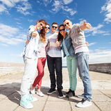 Teenagers showing thumbs up Royalty Free Stock Photos