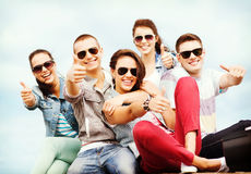 Teenagers showing thumbs up Royalty Free Stock Photography