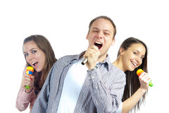 Teenagers singing on microphones Royalty Free Stock Photos