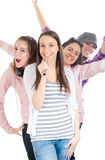 Teenagers singing on microphones in line Royalty Free Stock Photography