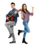 Teenagers singing. And playing guitar, having fun, full body shot stock photos