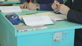 Teenagers sitting at the school desk indoors stock video footage