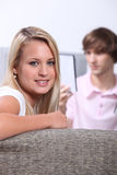 Teenagers sitting on sofa Royalty Free Stock Image