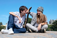 Teenagers sitting by a street Royalty Free Stock Photo