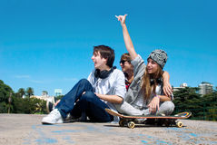 Teenagers sitting by a street Stock Photography
