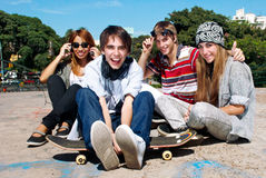 Teenagers sitting by a street Stock Photo