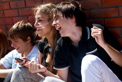 Teenagers sitting by a street royalty free stock photography