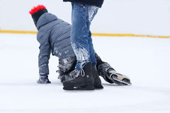 Teenagers skate on the ice rink skating. The teenagers skate on the ice rink skating royalty free stock photos