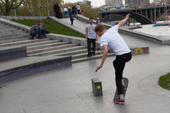 Teenagers are skateboarding. Boy jump on skateboard on the site Royalty Free Stock Image