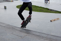 Teenagers are skateboarding. Boy jump on skateboard on the site Royalty Free Stock Photo