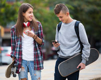 Teenagers with skateboards outdoors Stock Photo