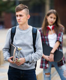 Teenagers with skateboards outdoors Stock Images