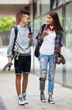 Teenagers with skateboards walking Stock Images