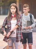 Teenagers with skateboards walking Royalty Free Stock Photography