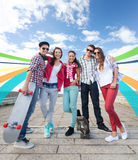 Teenagers with skates outside Stock Photo