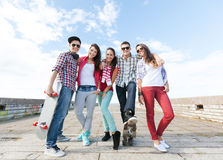 Teenagers with skates outside stock image