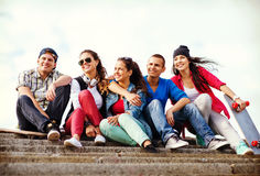 Teenagers with skates outside Stock Images