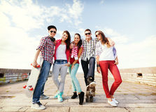 Teenagers with skates outside Royalty Free Stock Photography
