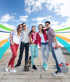 Teenagers with skates outside Stock Photography