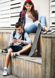 Teenagers with smarthphones Royalty Free Stock Photography