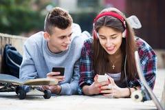Teenagers with smarthphones Stock Image