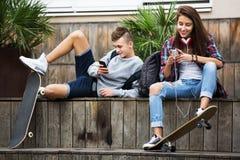 Teenagers with smarthphones Stock Photos