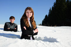 Teenagers in the snowdrift Royalty Free Stock Photography