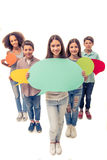 Teenagers with speech bubbles royalty free stock photo