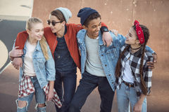 Teenagers spending time at skateboard park. Teenagers having fun concept Stock Images