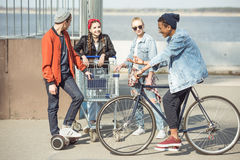 Teenagers spending time in skateboard park, hipster style concept. Stylish teenagers spending time in skateboard park, hipster style concept Stock Photos