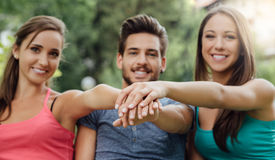 Teenagers stacking hands Royalty Free Stock Photos