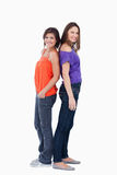 Teenagers standing back to back Stock Image
