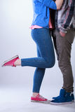 Teenagers standing close and hugging. On  background Royalty Free Stock Images