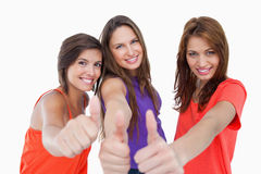 Teenagers standing with their thumbs up Royalty Free Stock Photography