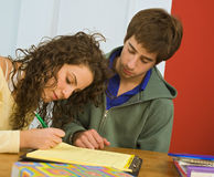 Teenagers studing. Teenager couple that are studying together Stock Photo
