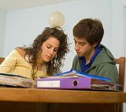 Teenagers studing. Teenager couple that are studying together Royalty Free Stock Photos