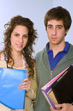 Teenagers studing standing. Teenager students couple looking at camera Royalty Free Stock Photo