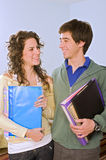 Teenagers studing standing. Teenager students couple looking at camera Stock Images