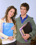 Teenagers studing standing. Teenager students couple looking at camera Royalty Free Stock Image