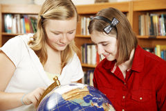 Teenagers Study Globe Stock Image