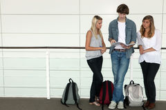 Teenagers studying in corridor Royalty Free Stock Images