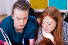 Teenagers studying in focus Royalty Free Stock Image