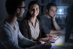 Teenagers studying late at night royalty free stock images